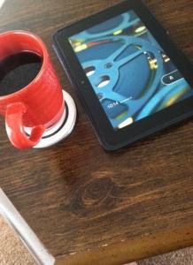 redcoffee mug and kndle